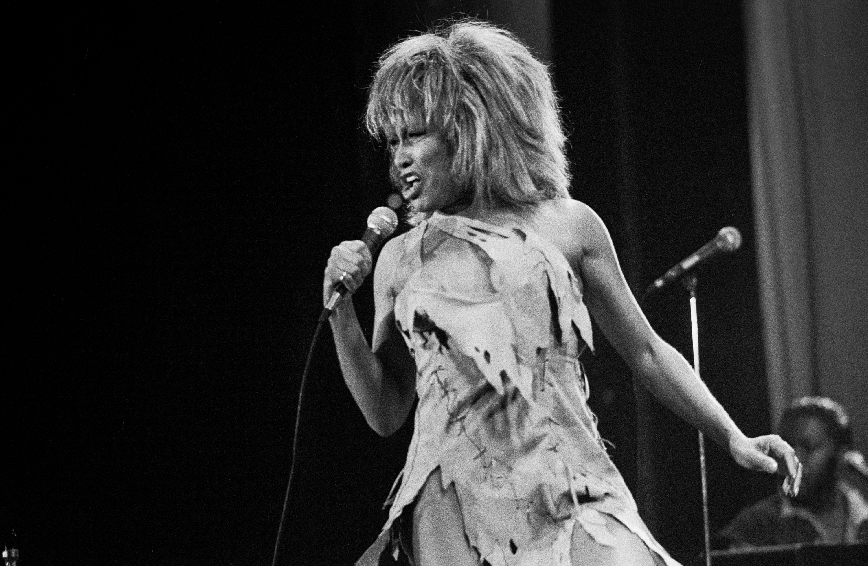 Tina Turner performing with ripped dress and signature big hair in 1983