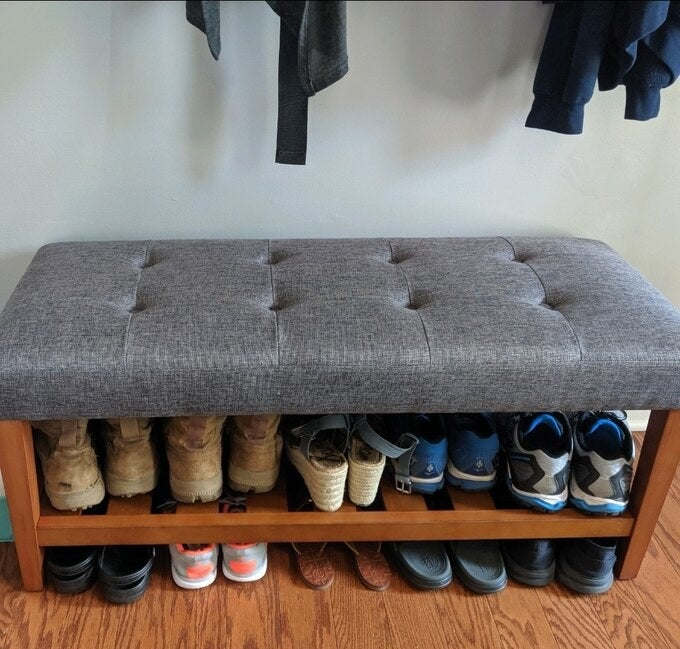 a reviewer's bench holding multiple pairs of shoes