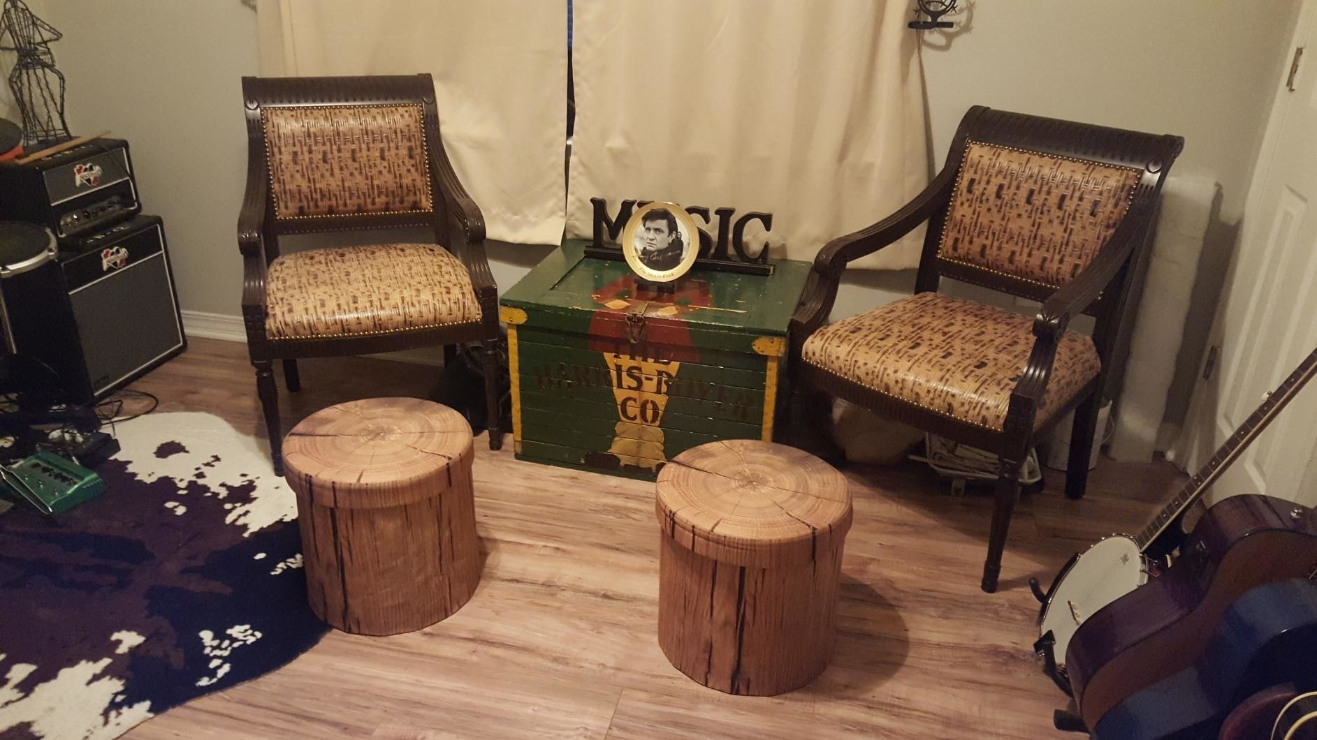 reviewer image of two sorbus 3D tree stump storage ottomans each in front of a brown armchair in a living room