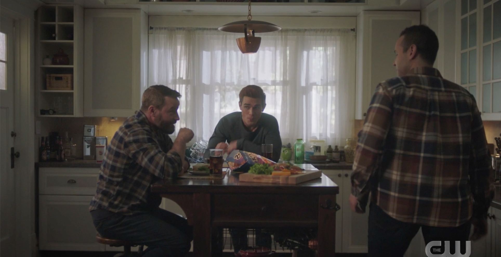 Archie, Frank, and Eric in the kitchen with Tostitos chips