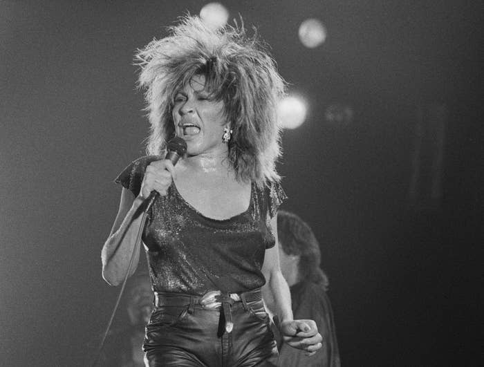 Black and white photo of Tina Turner performing in 1985