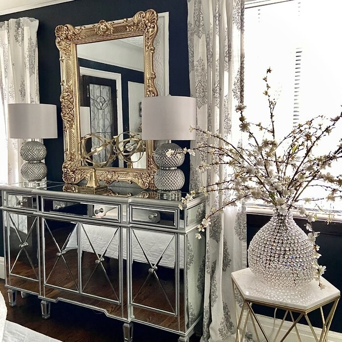 a reviewer's mirrored console used as a buffet table