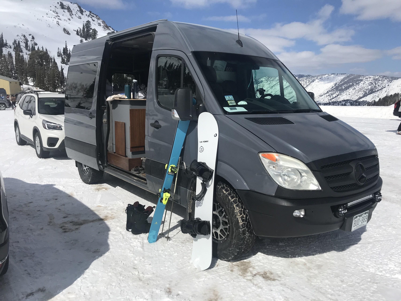 Gray van in a snowy parking lot