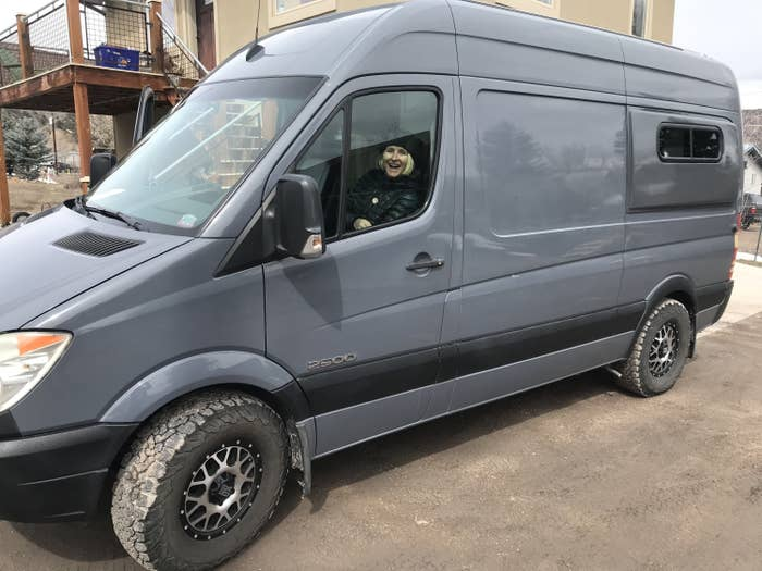 Woman driving a gray van