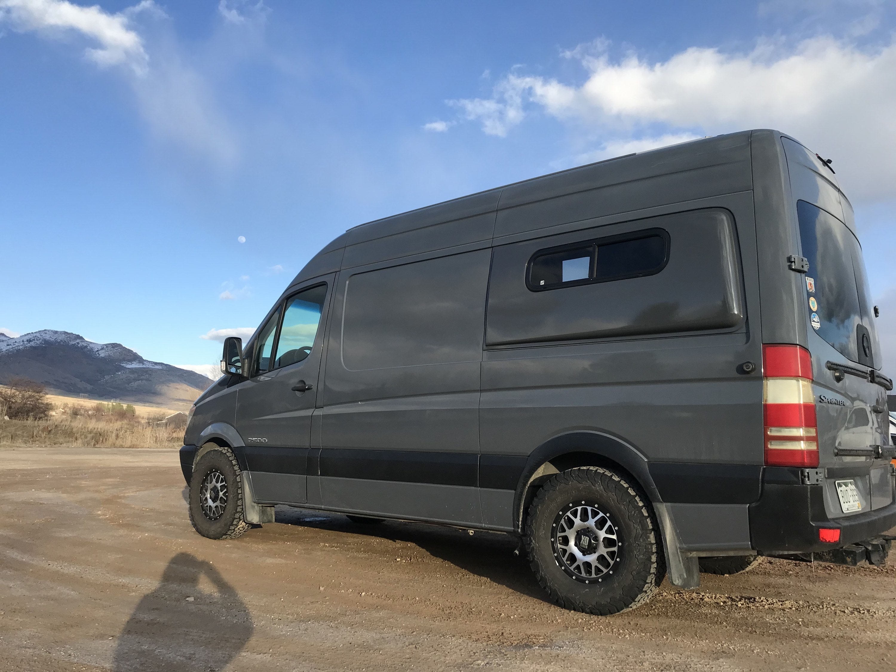 Van parked in a sunny parking lot