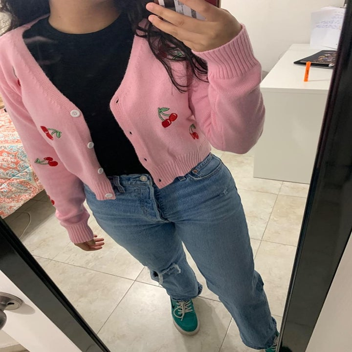 Reviewer wearing the pink cardigan with embroidered cherries