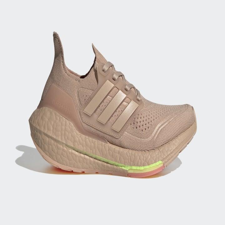 tan, neon yellow, and pink Adidas Ultraboost sneaker