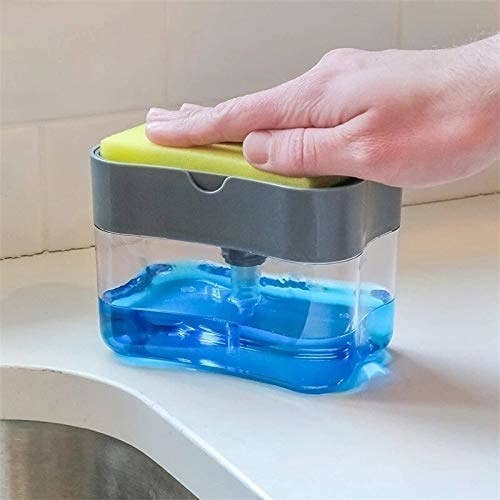 A liquid soap dispensing container with a pumping mechanism. It has a slot on the top for the sponge.