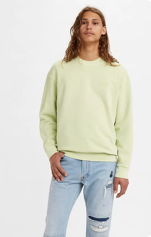 Model wearing green crewneck with jeans