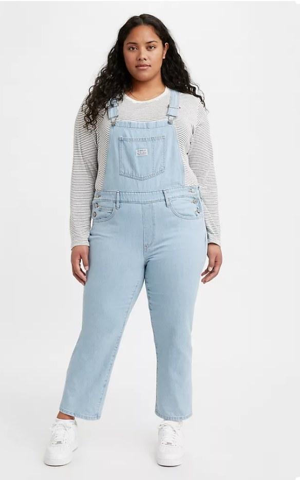 Model wearing long denim overalls