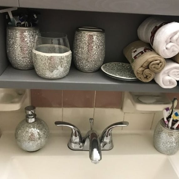 a reviewer's accessory set over their bathroom faucet