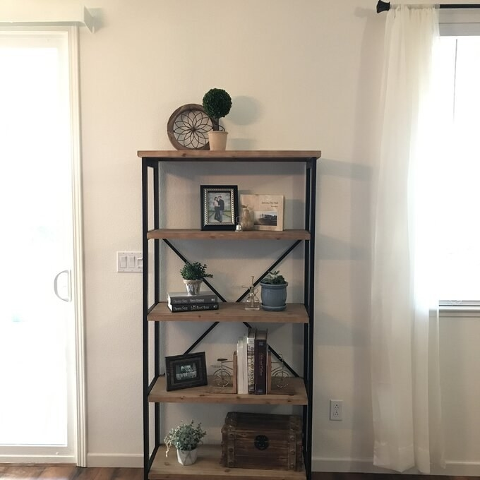 a reviewer's bookcase with books and knickknacks