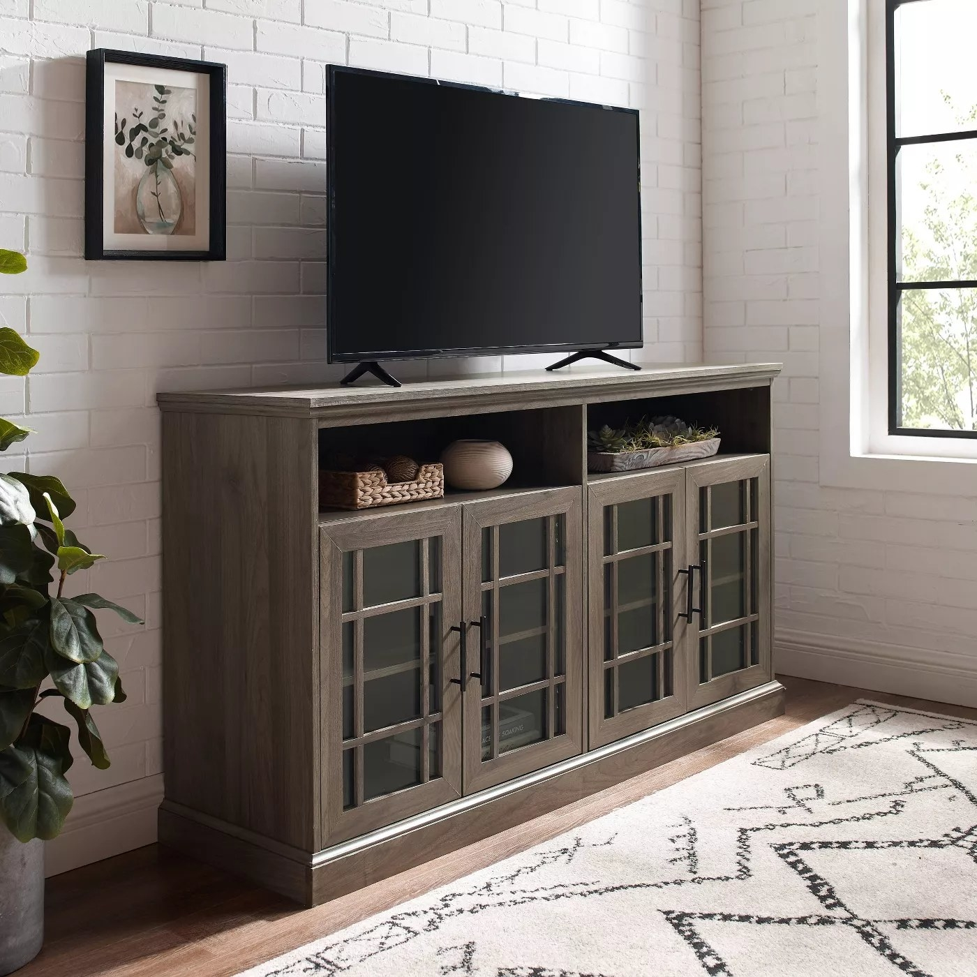 The slate gray and dark walnut transitional TV stand