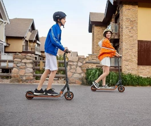 Two kids on electric scooters
