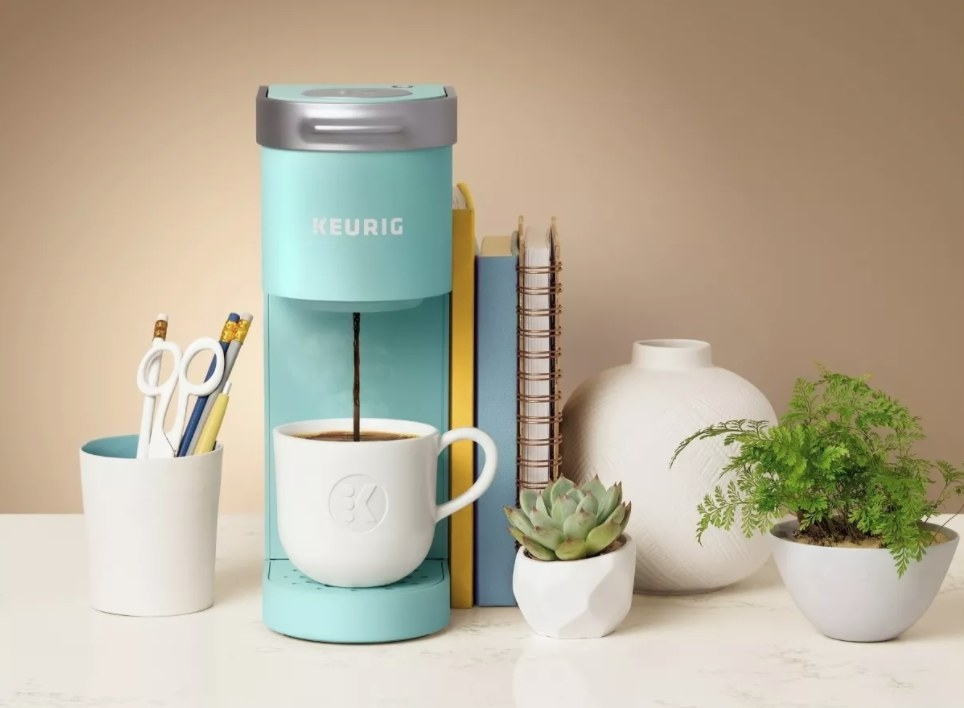 A light blue Keurig mini coffee maker