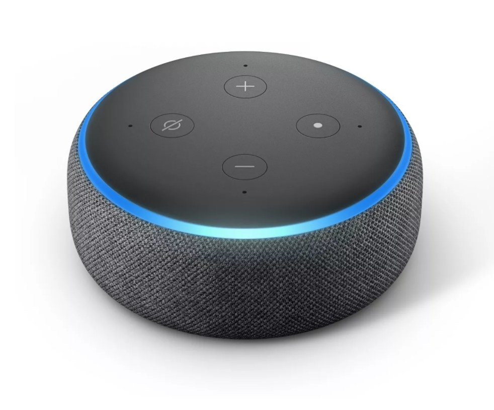 A small Amazon Echo Dot device