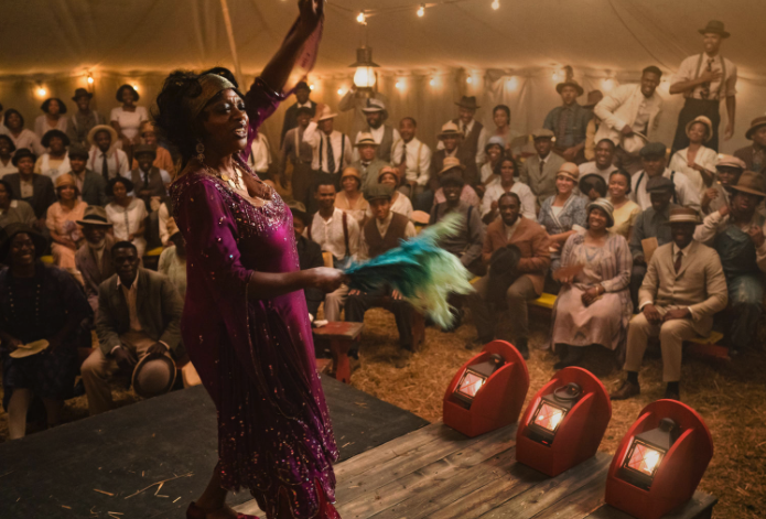 Viola Davis sings on a stage in a tent dressed in 1920s costume