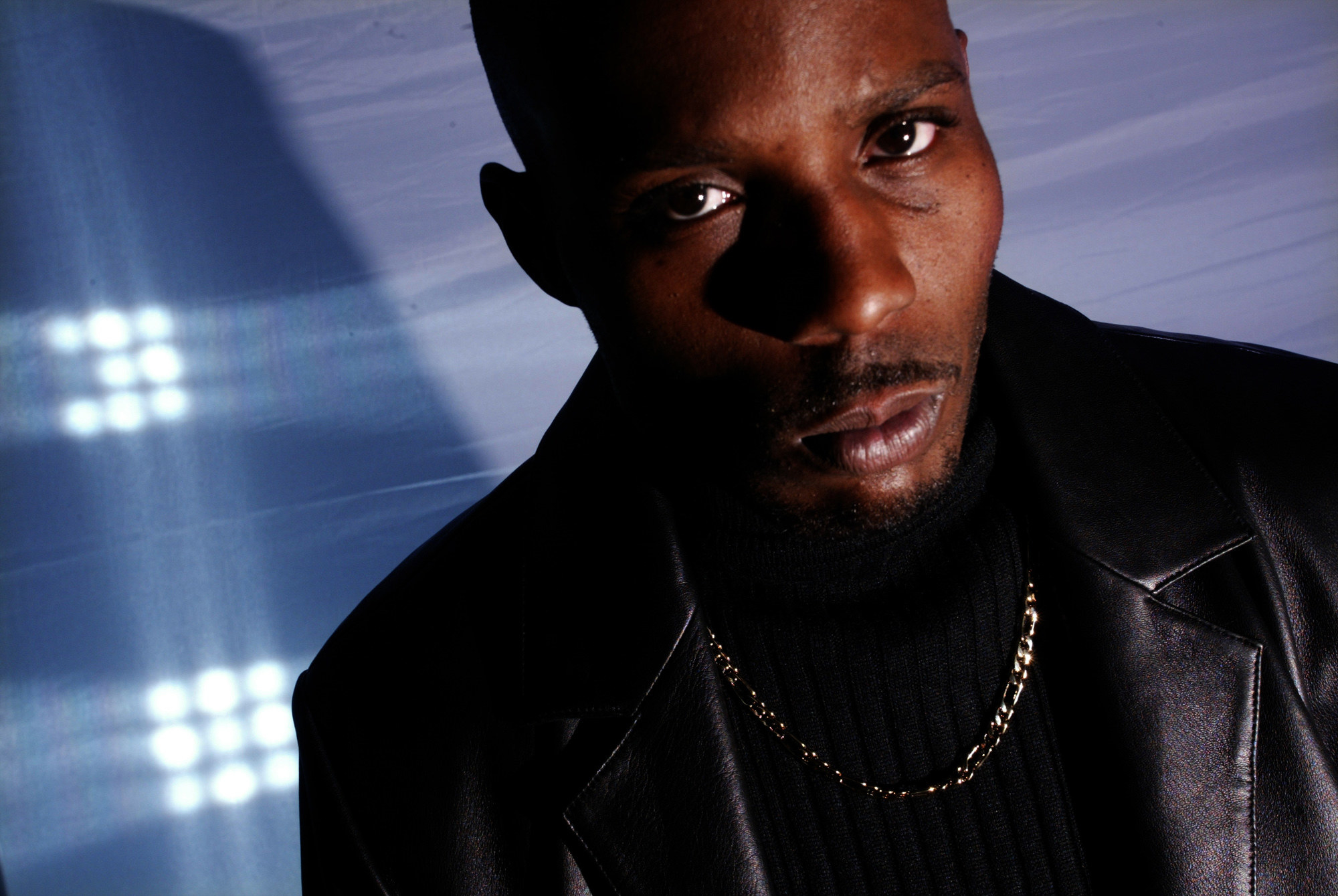 DMX in a black leather jacket gazes seriously at the camera