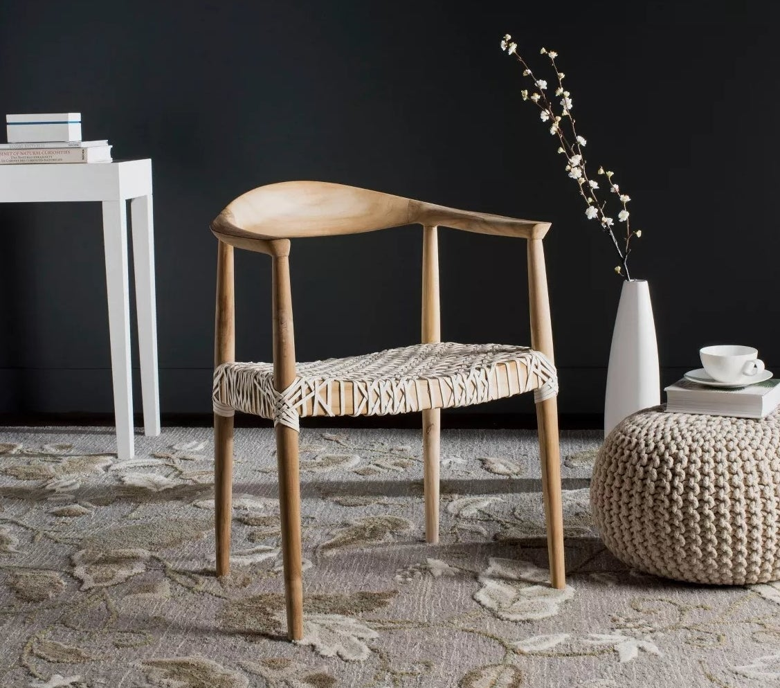 The teak and white leather armchair