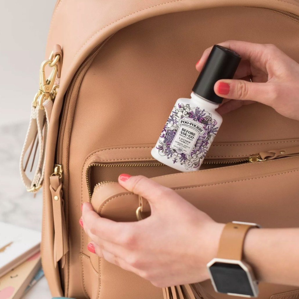 A travel-sized bottle of Poo-Pourri