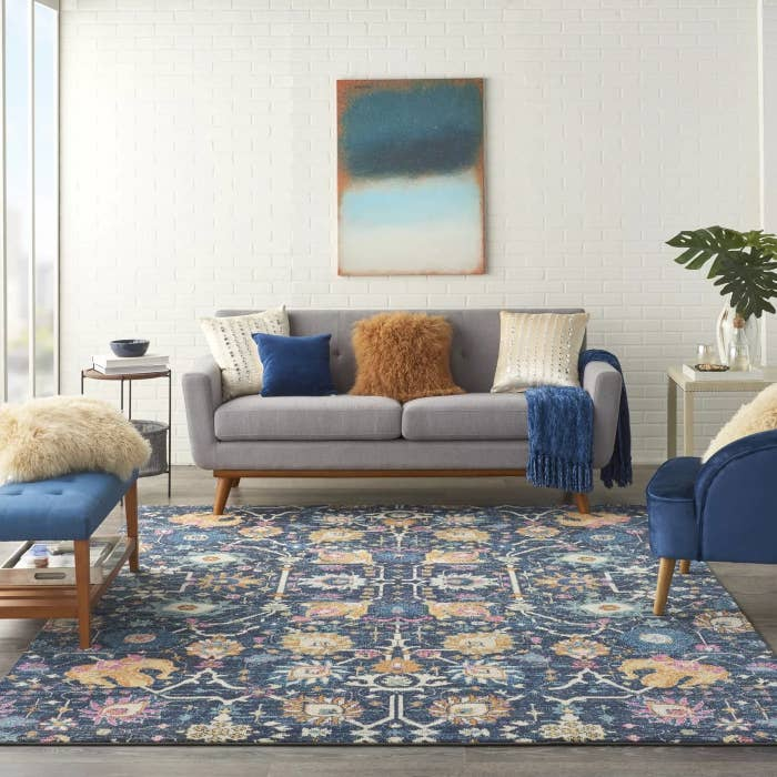 The blue area rug with a floral pattern