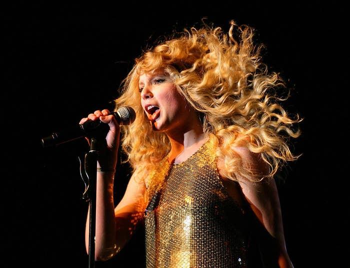 Taylor performing onstage