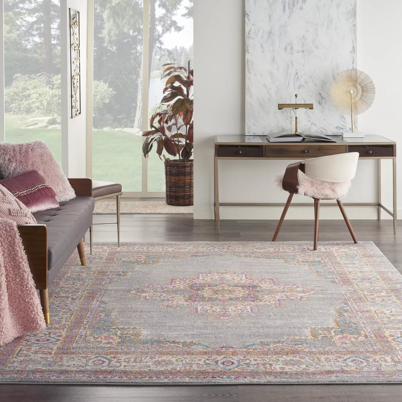 The gray rug with a pink border and medallion