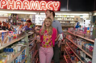 Carey Mulligan and Bo Burnham dance in character in a pharmacy in the movie Promising Young Woman