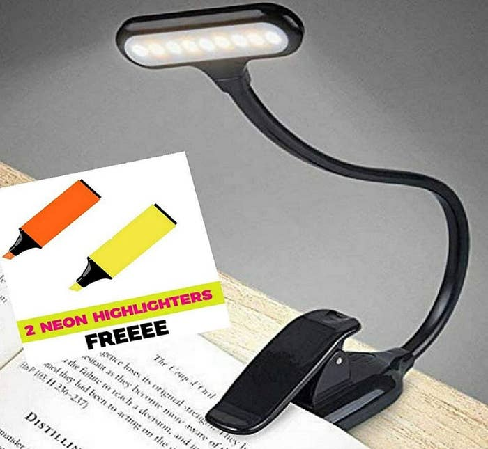 """A book light attached to a book, with an inset that says """"2 neon highlighters free""""."""