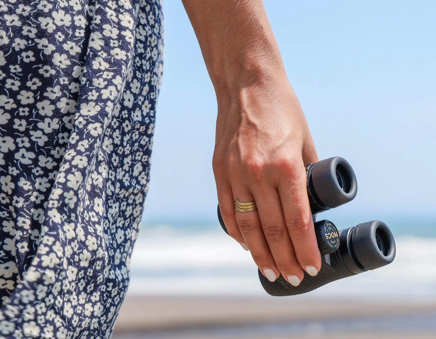 Women holding binoculars.
