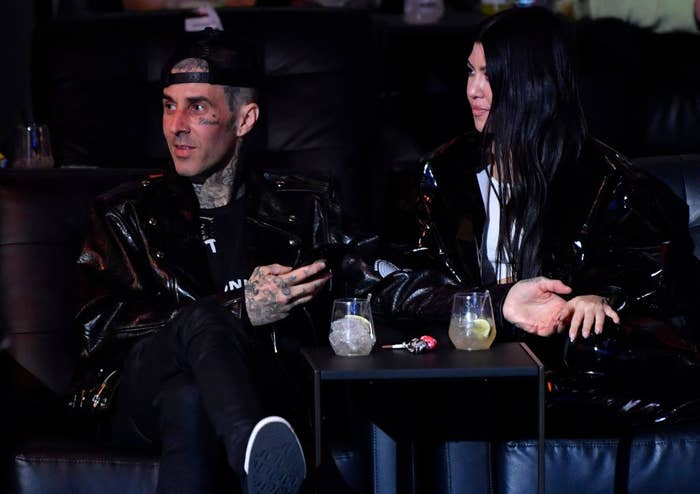 Travis Barker and Kourtney Kardashian are seen in attendance during the UFC 260 event