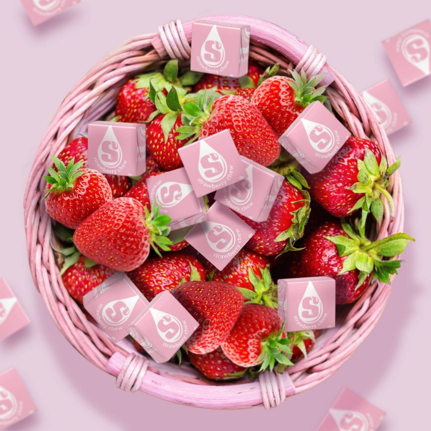 Pink starbursts in a pink basket with strawberries