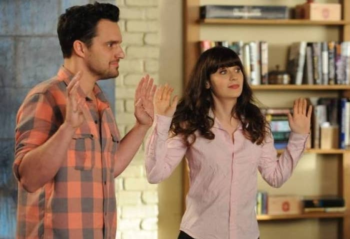 NIck and Jess hold up their hands on New Girl