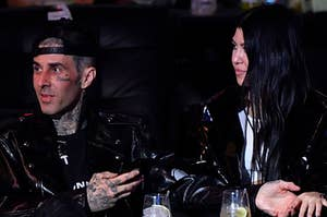 Travis Barker (L)  and Kourtney Kardashian are seen in attendance during the UFC 260 event