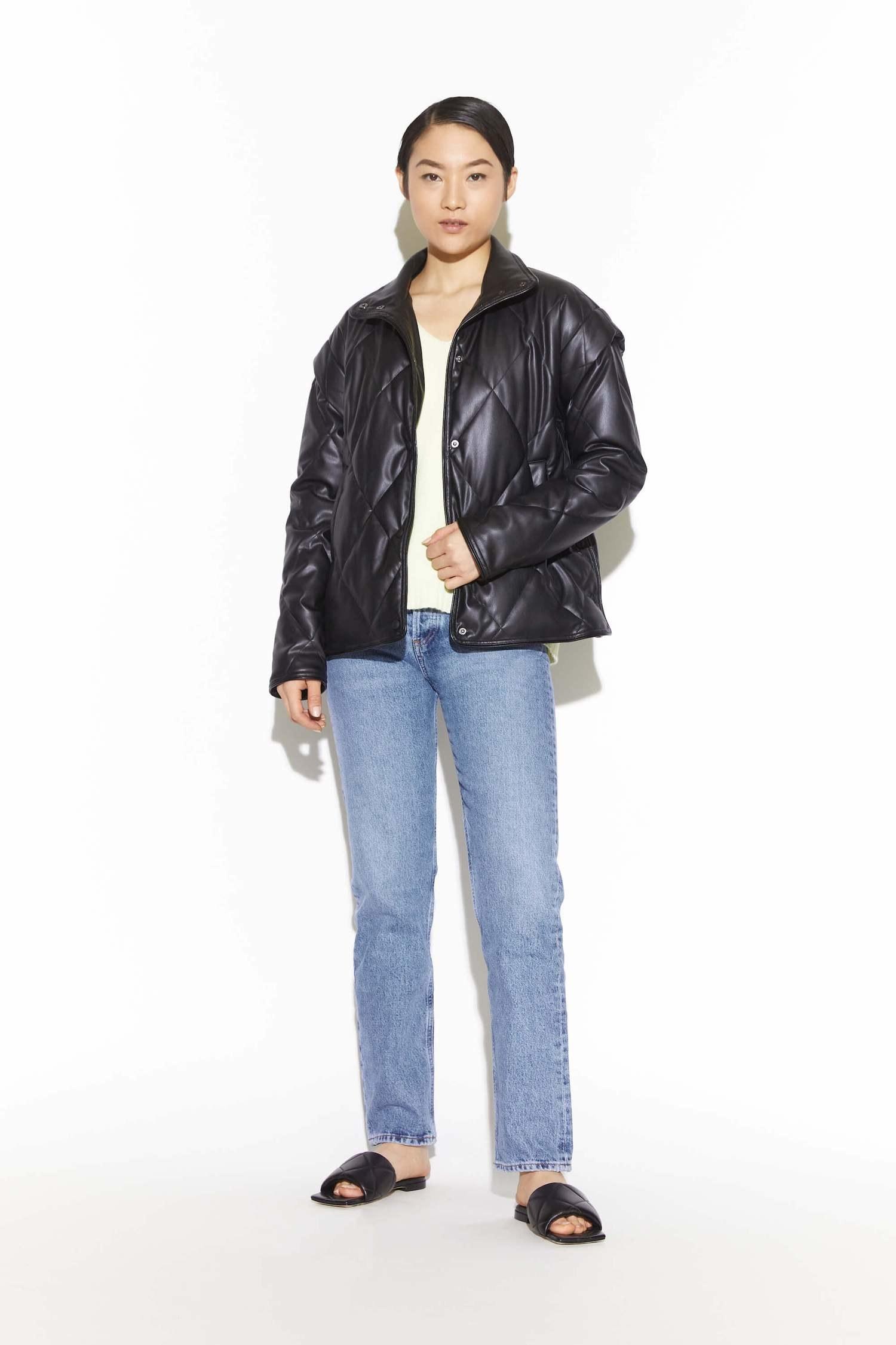 model in lightweight vegan leather puffer jacket