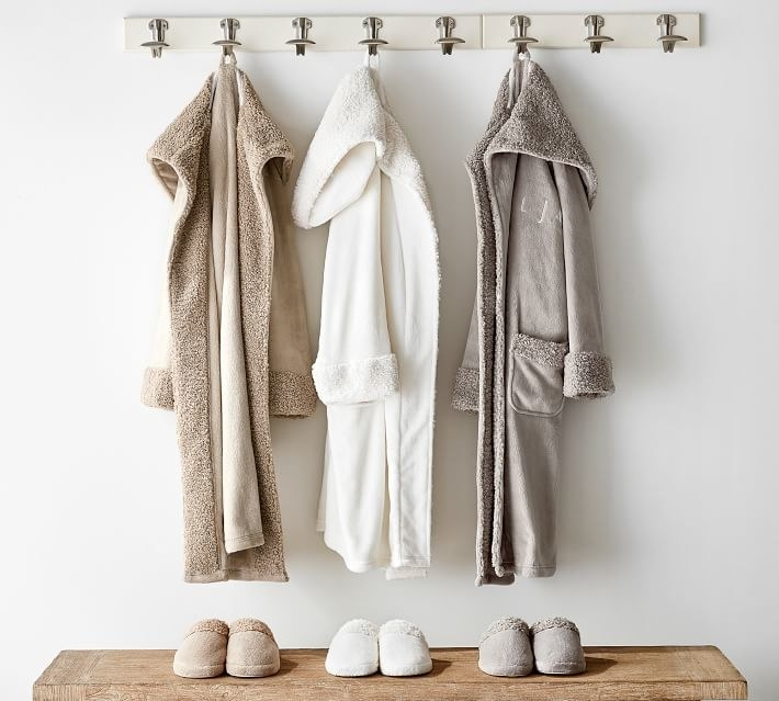 three robes in nude, white, and gray