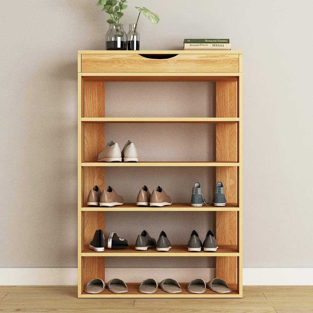 A tiered shoe rack with a built-in drawer