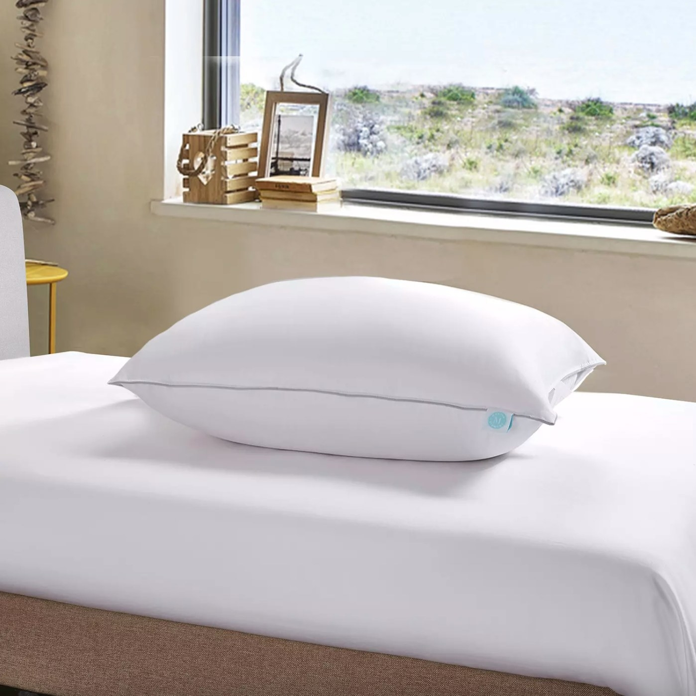 The 400 thread count down pillow in white on a bed