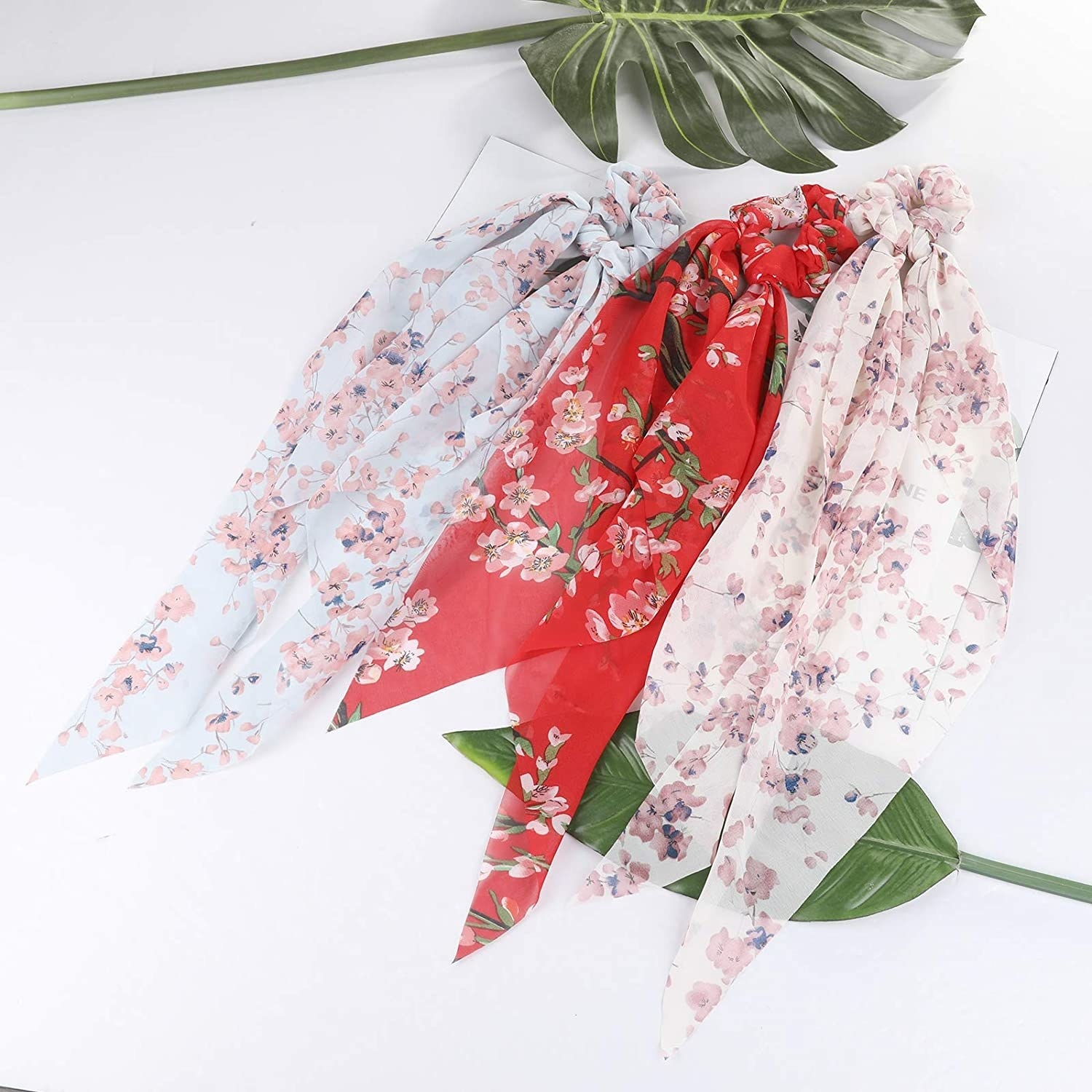 Three floral scrunchies with matching handkerchiefs attached to each