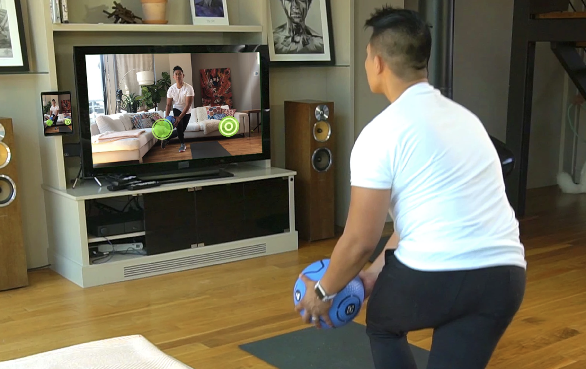 A person using the medicine ball with a TV