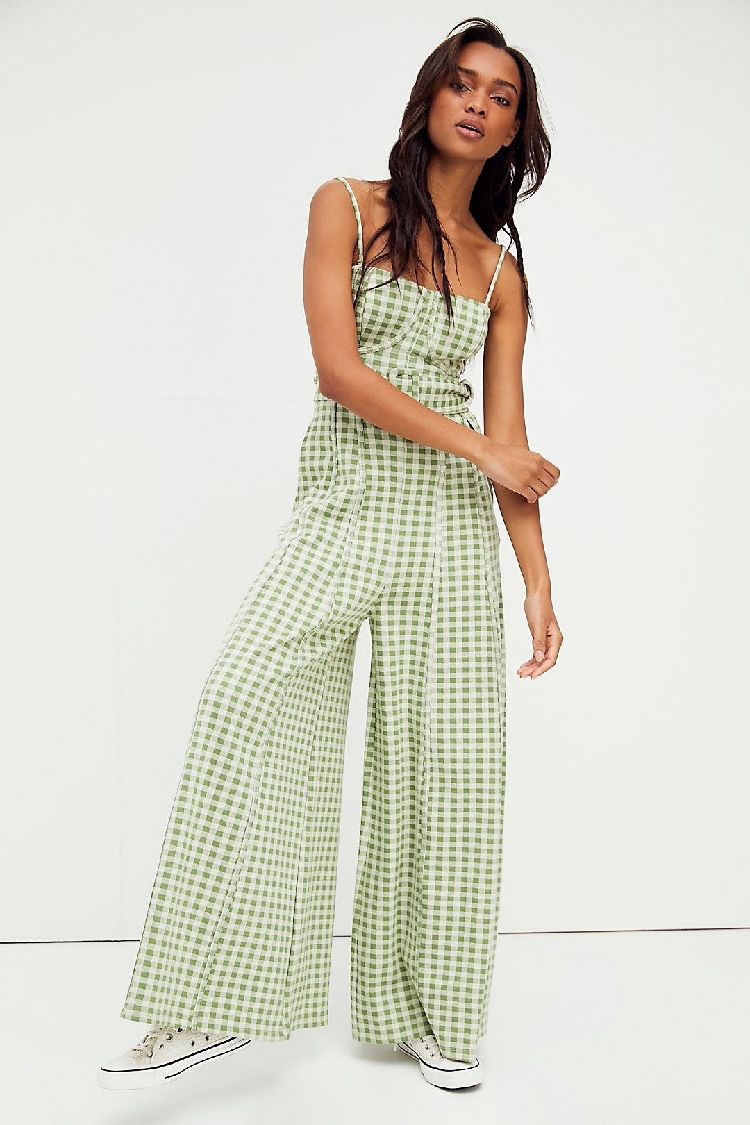 model wearing the floor length green and white checkered jumpsuit