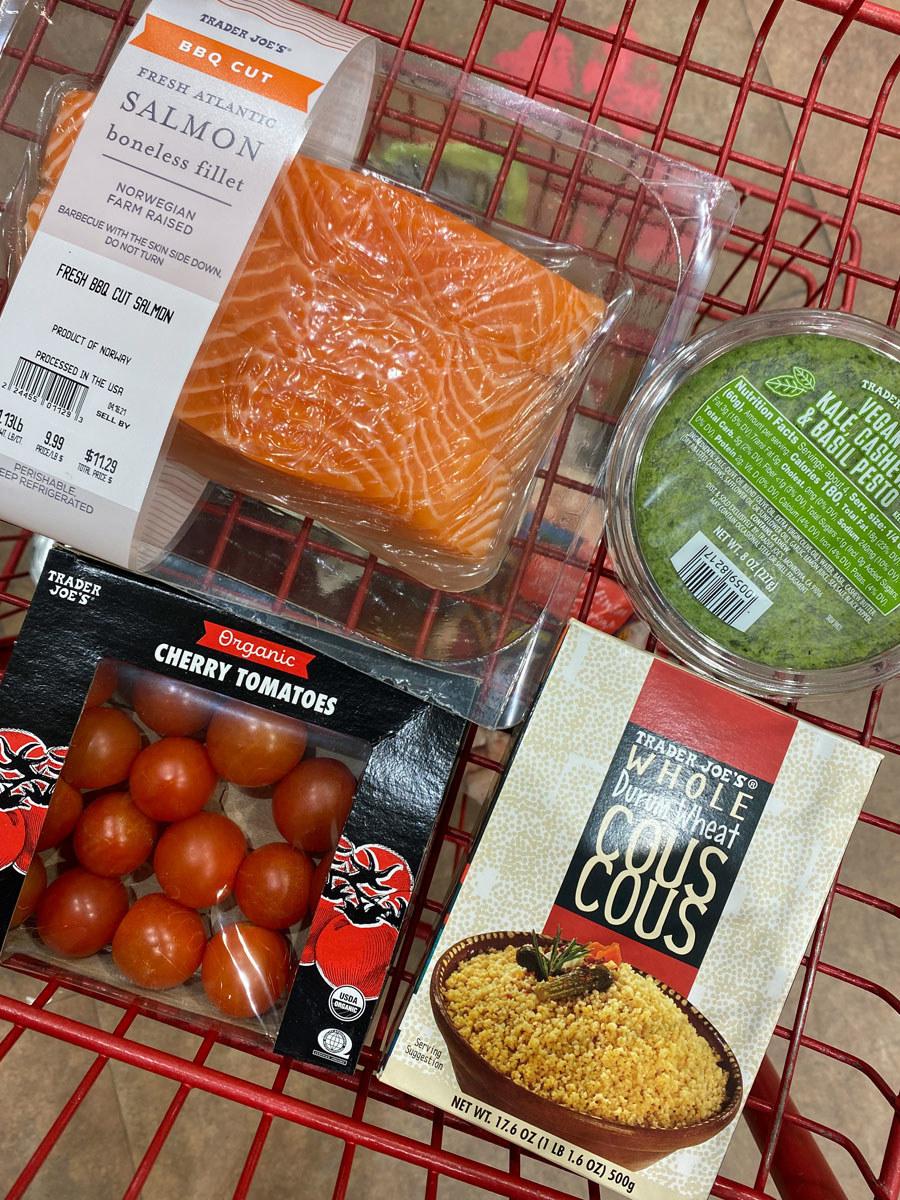 BBQ cut salmon fillets + cherry tomatoes + couscous + kale, cashew, and basil pesto