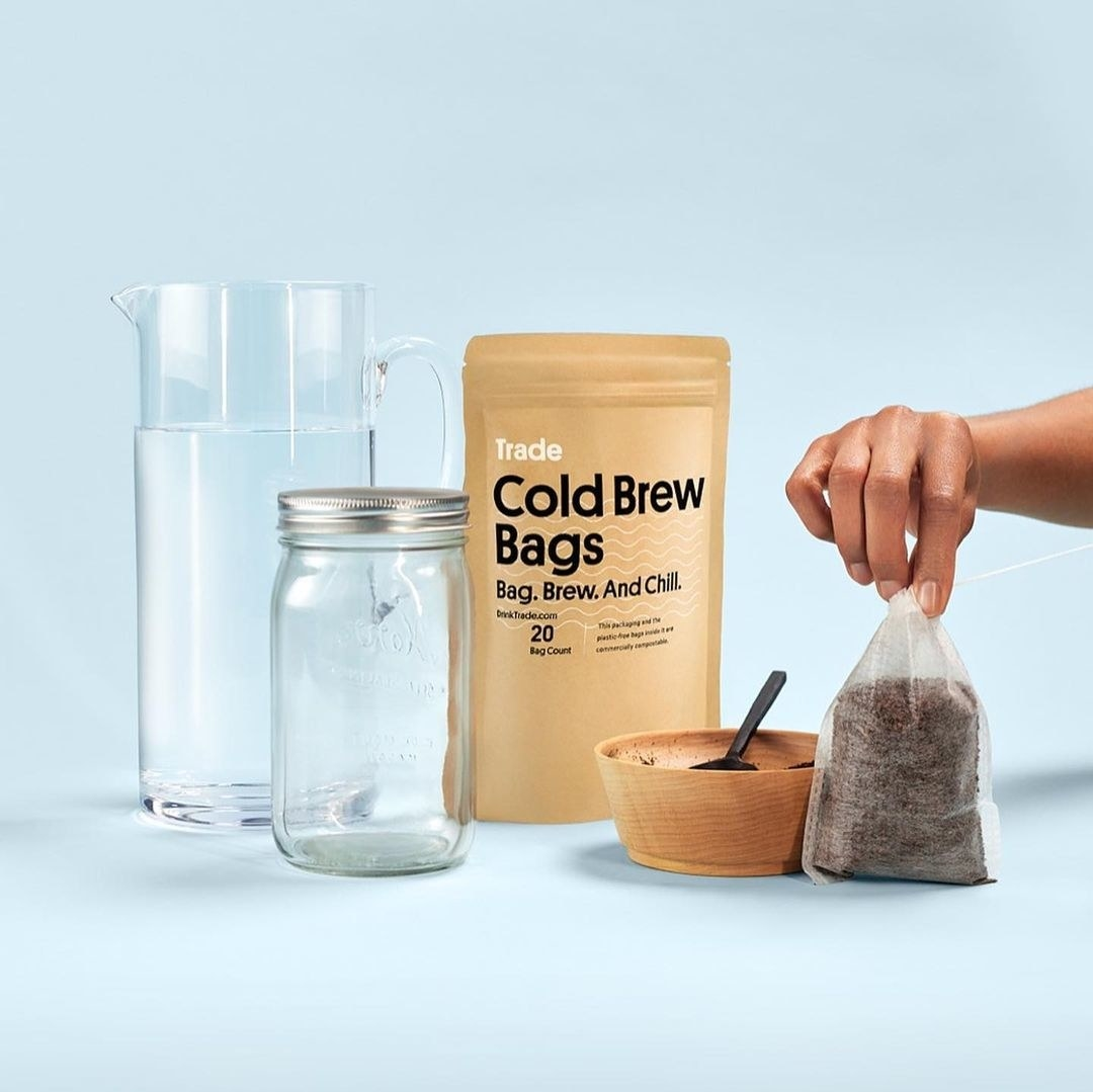 a pitcher, a mason jar, and cold brew coffee bags