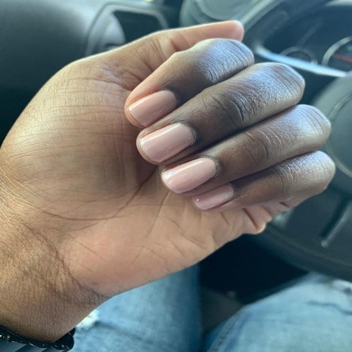 A reviewer showing off their nail polish after using the lamp