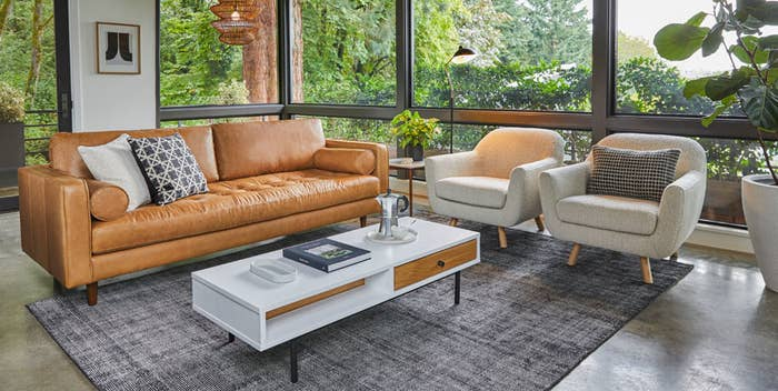 A well decorated living room with a leather sofa from Article