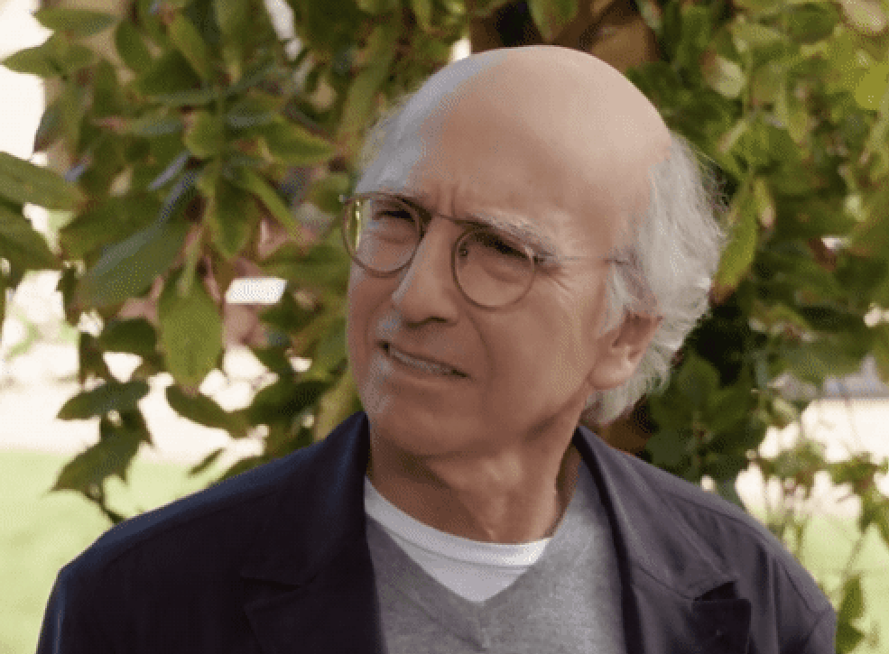Larry David making an annoyed face