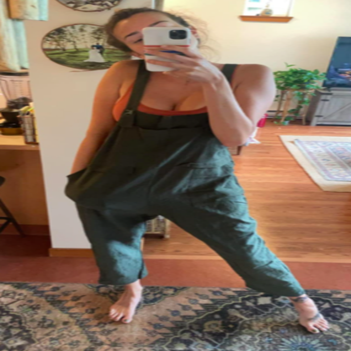 A customer review photo of them in the army green overalls