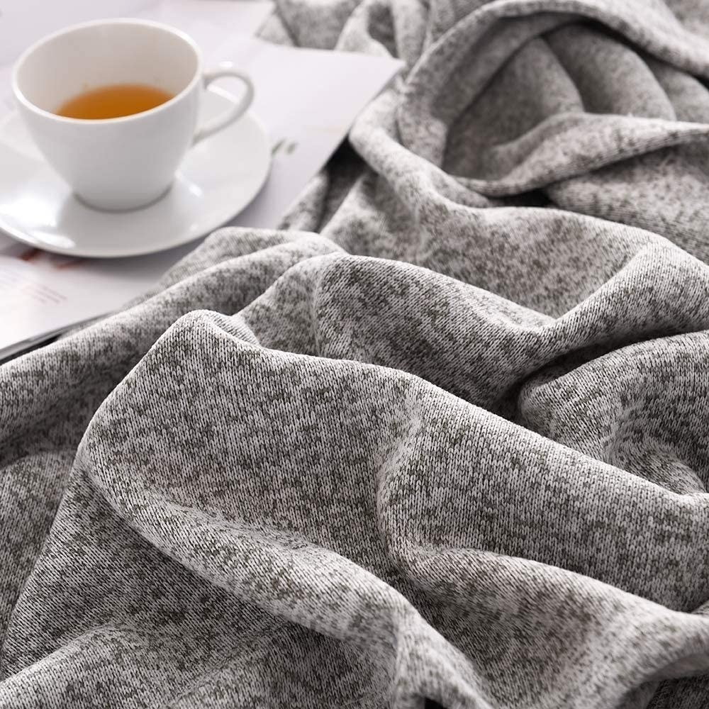 The blanket next to a cup of tea