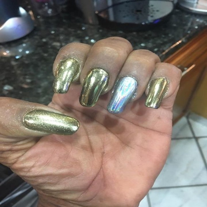 A reviewer showing off their nails with the colors champagne gold and laser silver