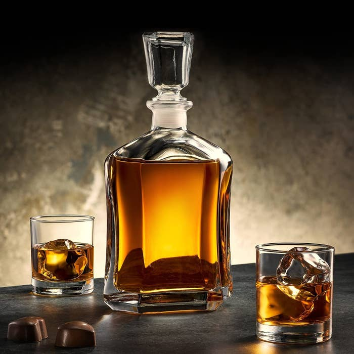 glass faceted bottle decanter full of whiskey, with faceted glass topper